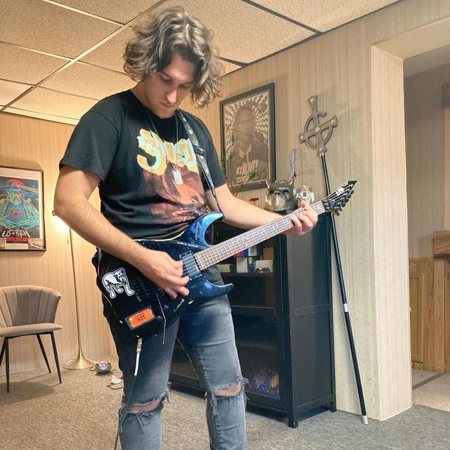 a ghoul guitarist