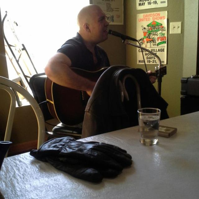 Songwriter, acoustic guitarist
