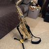 Wayne plays bass and sax