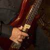 Wayne plays bass
