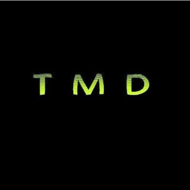 T M D