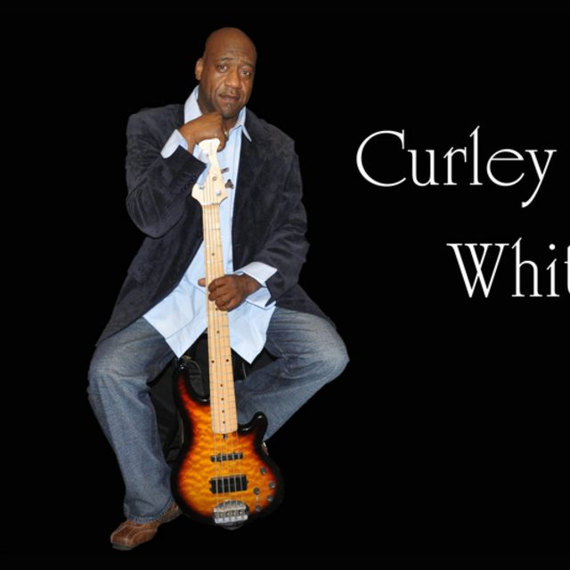 Curley White